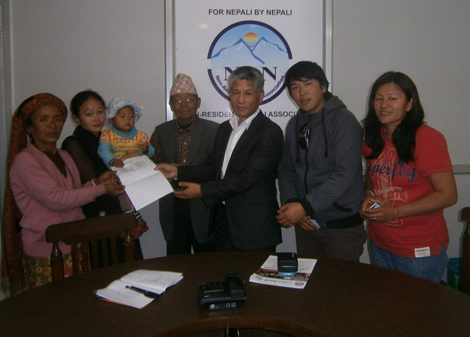 Anish Khaling Rai's family and supporters with NRN President Shesh Ghale.