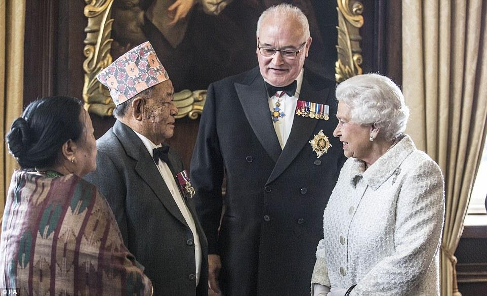 Captain Rambahadur Limbu VC, 76 and wife meet the queen.