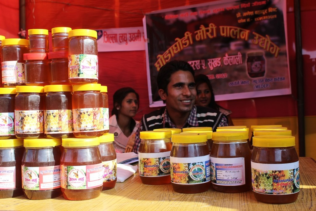 Honey being sold at a fair in Dhangadhi