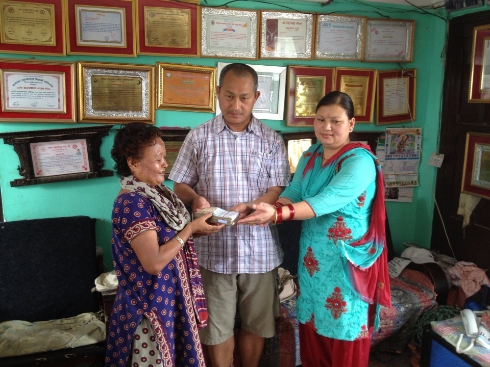 Parents of Laxmi Gurung donating the collected amount from people all over to Dil Shova Shrestha