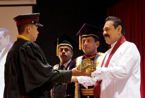 His Excellency President Mahinda Rajapaksa presents the Ceremonial Sword to Nepal Army's Lieutenant Jit Bahadur Pun Magar. Photos courtesy: Anita Pariyar