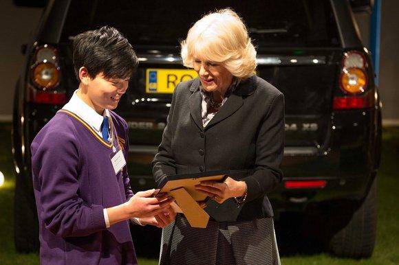 Mukahang Limbu receiving a certificate from The Duchess of Cornwall