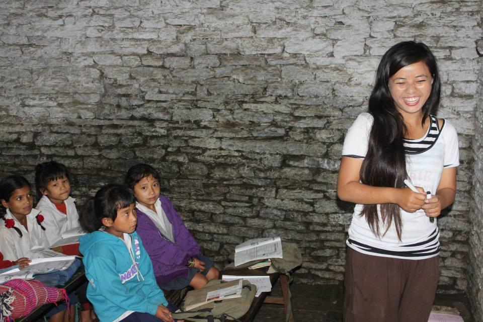 Neelam Gurung teaching children at Tikhyang School, Ghandruk