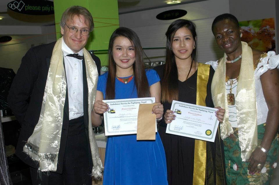 Anugya and Rasna Limbu receive their prize and certificates.