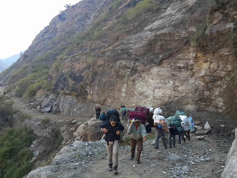 Carrying blankets to pandhara , one of the remotest place in far west - Nyano Sansar