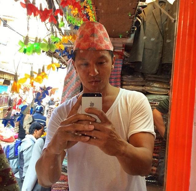 Wearing a Dhaka topi (Instagram: PrabalGurung)