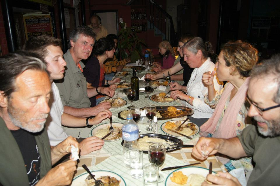 Guests Enjoy Rabbit Meat With Wine at Du Chat Perche Restaurant