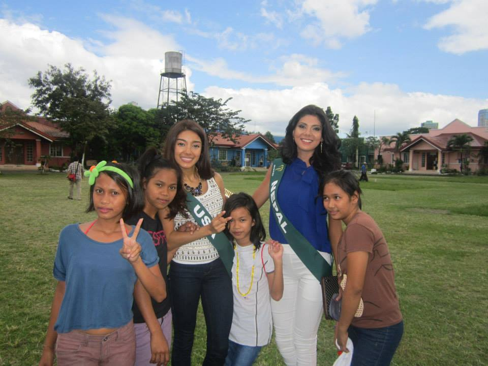 Miss Nepal Earth with Miss USA Earth, meeting the victims of the recent typhoon.