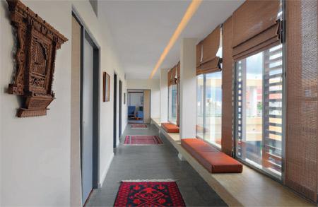 Upper floor western corridor, with master bedroom at far end.