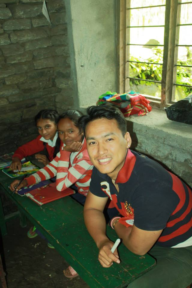 Project United member Sachin Pun with the children.
