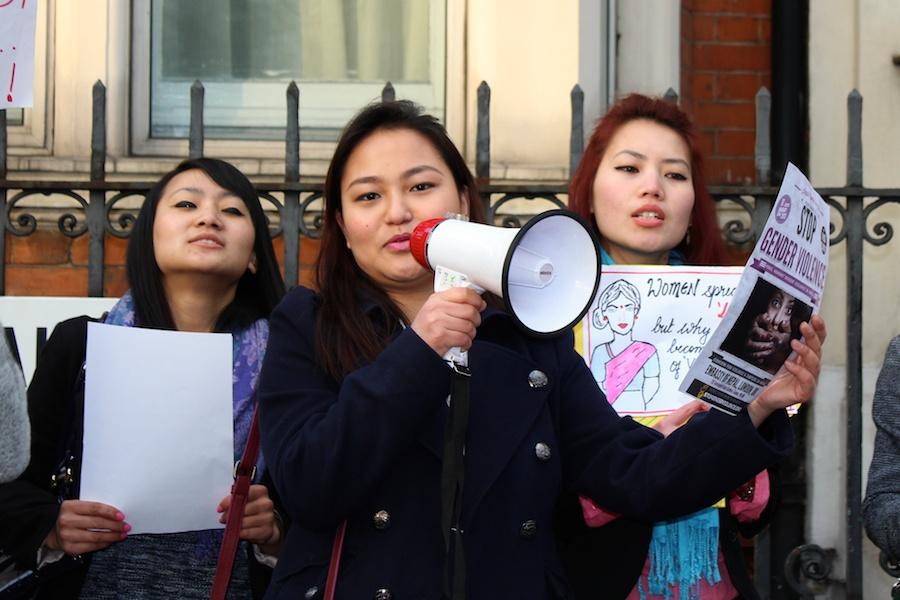 Laxmi Gurung taking charge of the megaphone. Ranjana Rai and Durga Gurung in the background.