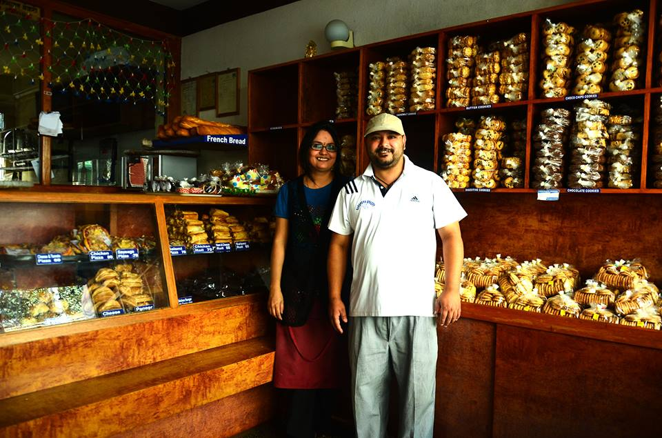 """"""" Started with just two of us and and now I employ 10. It's been 9 years now. I learnt how to bake from my dad's brother. He used to run a bakery in Pulchowk. I have been in this industry for almost 20 years. Time flies pretty fast."""" Love Marriage?  Smiles. """"No. Arranged."""" - Bimal Bhandari & Mitu Bhandari, Local Bakers, Kathmandu"""