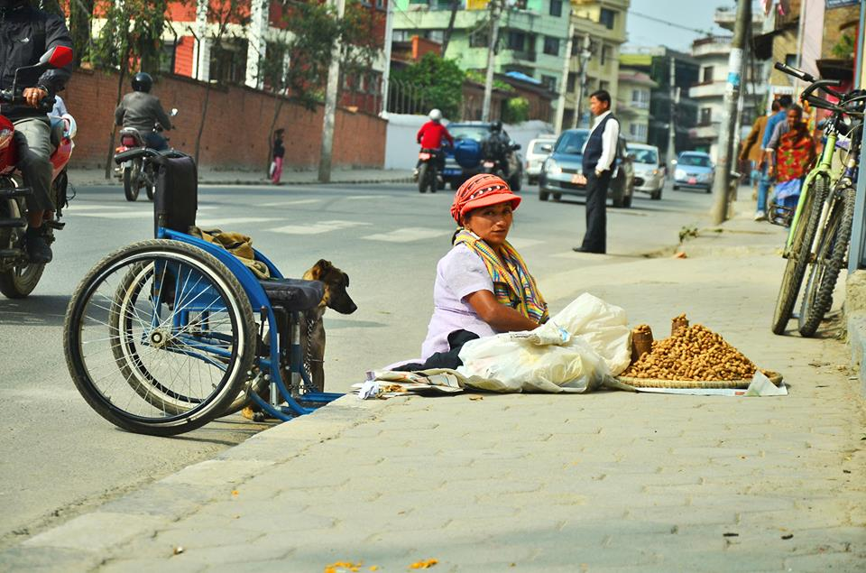 """"""" I have no expectations from the government, but I have request to all the good people of Kathmandu. It is not your money we want. At least be kind enough to stop the vehicles while we cross the road or help us cross the road. """" - Bishnu Maya Maharjan, 27 yrs, Differently Abled Street Vendor, Kathmandu"""