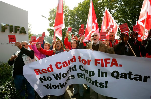 Before a meeting of FIFA's executive committee, union activists protested working conditions at World Cup stadiums in Qatar. - Arnd Wiegmann/Reuters