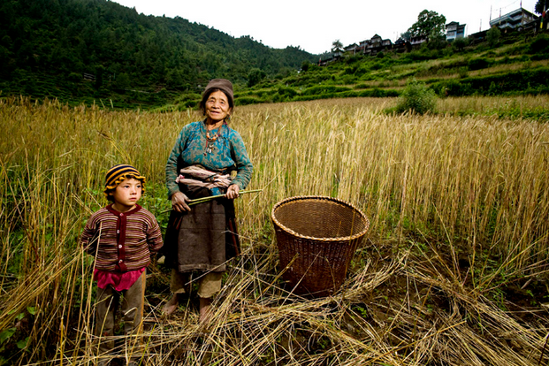 A Tamang woman and child from the hilltop village of Thulo Syabru, Langtang Valley Photo & Caption: Simon de Trey-White