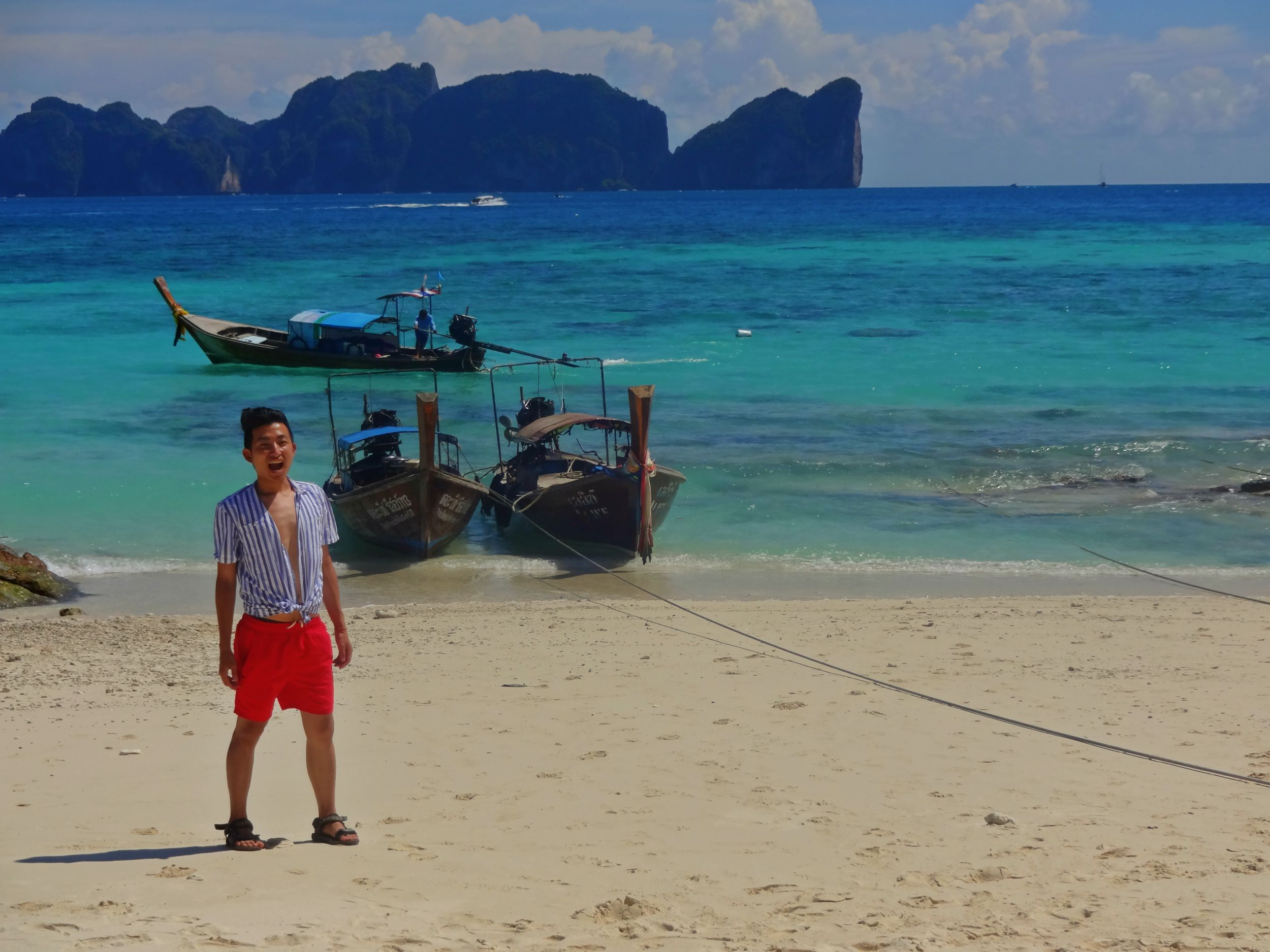 Aug 19: Arriving in Phi Phi Island was breathtaking. It was also the place where we spent a little extra and stayed at a very nice resort. At our beach in front of the resort and I kid you not, it was even more beautiful there... Our biggest regret? Not staying an extra night.