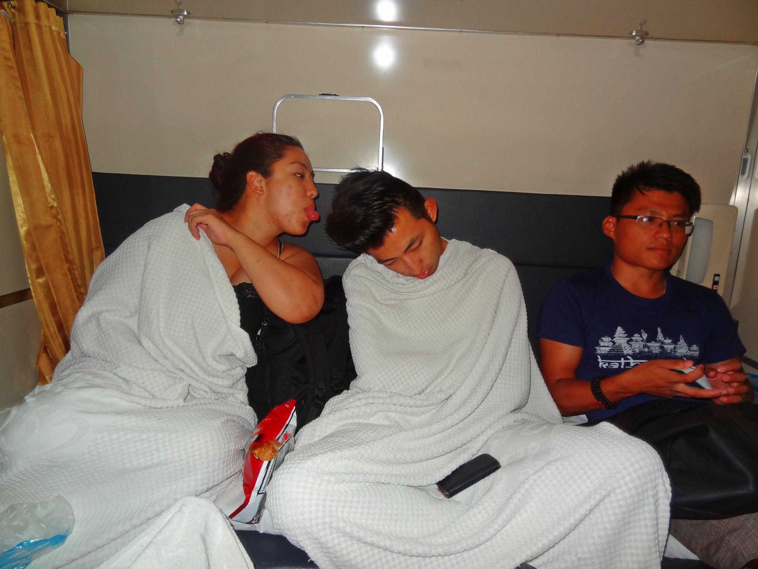 """Aug 15: Departed for Chiang Mai on a sleeper train in the evening. The 12 hour journey ended up taking around 15 hours. I would definitely recommend the overnight train. It was around £20 for one way A/C sleeper compartment. I sleep through anything so I had no problem. Us... """"socialising"""" haha! Celebrating Jason's budday on the train."""