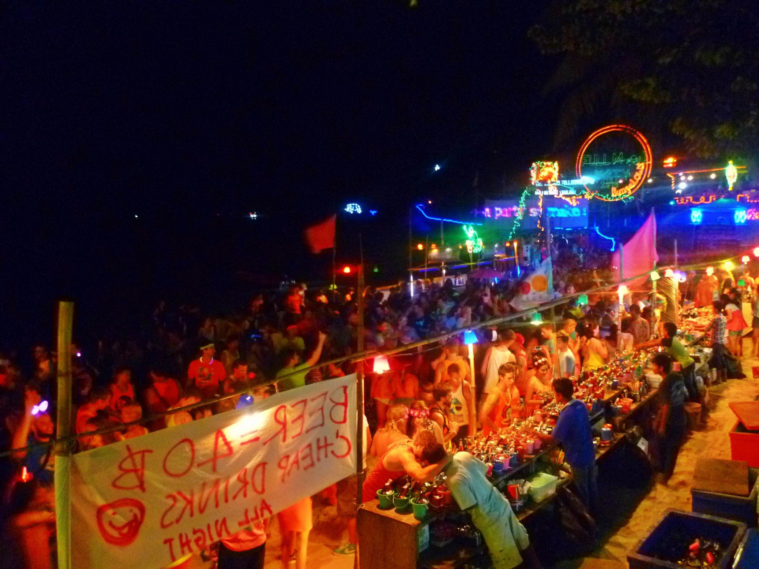 """Aug 21: The world famous Full Moon Party at Haad Rin beach. After a few days at Haad Rin, I wanted out. It was loud and just alcohol. But I believe it was more """"in our face"""" as we were at the heart of the party."""