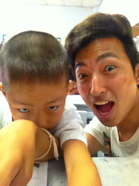 """Sept 13: Us volunteers were also taken to a school nearby where we said Hello to the children. This was Wei and he loved colouring. The children loved to """"play-fight"""", I was pretty tired after lifting everyone up and pretending to make them superman."""